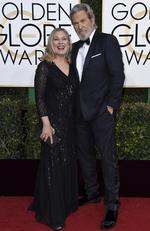 Susan Geston and Jeff Bridges attend the 74th Annual Golden Globe Awards at The Beverly Hilton Hotel on January 8, 2017 in Beverly Hills, California. Picture: AP