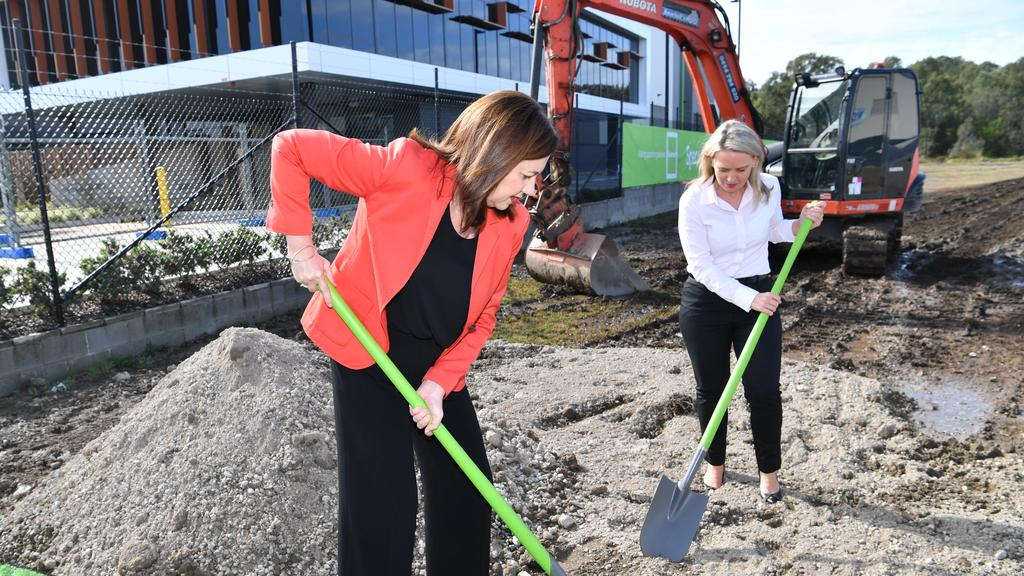 Queensland Premier Annastacia Palaszczuk and the Minister for State Development, Tourism and Innovation, Kate Jones digging at the site of the new Amazon hub. Picture: AAP Image/Darren England