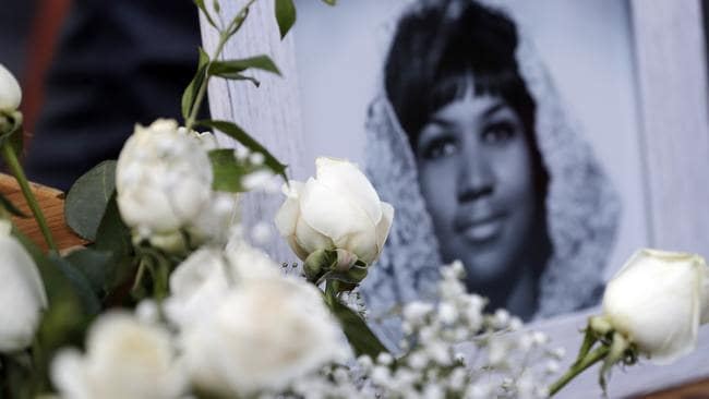 Flowers and pictures are placed on Aretha Franklin's star at the Hollywood Walk of Fame. Credit: AP/Marcio Jose Sanchez