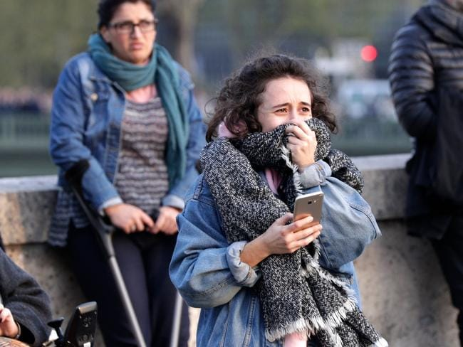 Bystanders were devastated by the fire. Picture: Geoffroy Van Der Hasselt / AFP