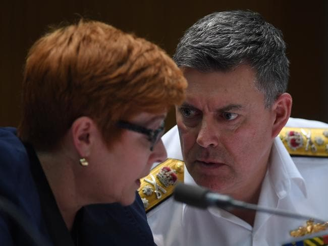 Vice Admiral Ray Griggs speaks to Defence Minister Marise Payne during Senate estimates hearings at Parliament House in Canberra.