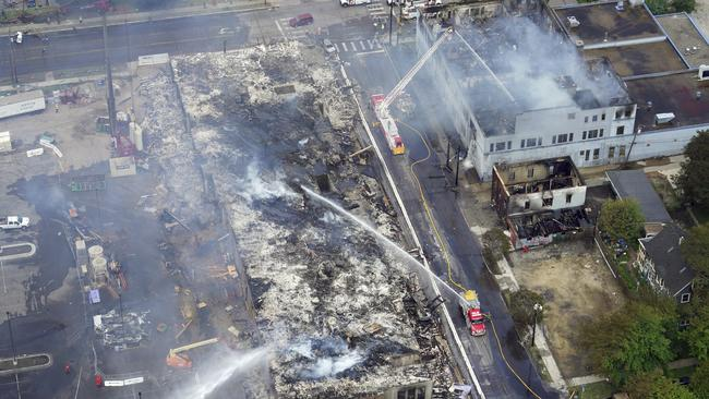 The Midtown Corner apartment building was burned to the ground. Picture: Brian Peterson/Star Tribune via AP