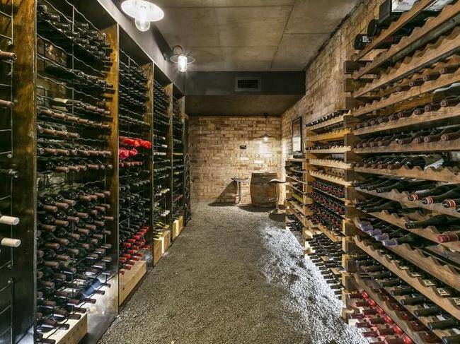 The wine cellar that can hold 1700 bottles in a temperature controlled atmosphere.