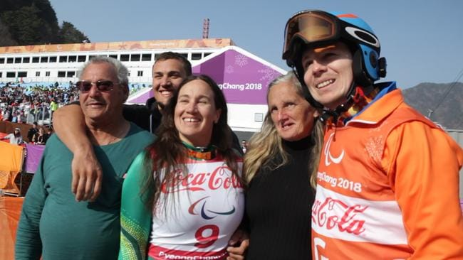 Australian Paralympian Melissa Perrine and her family after winning bronze.