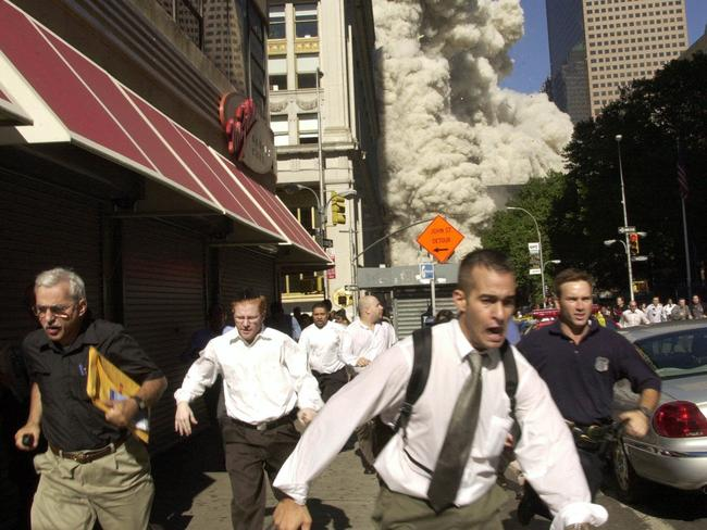 People run from the collapse of one of the World Trade Centre towers on Tuesday, September 11, 2001 in New York City. Picture: Suzanne Plunkett/AP