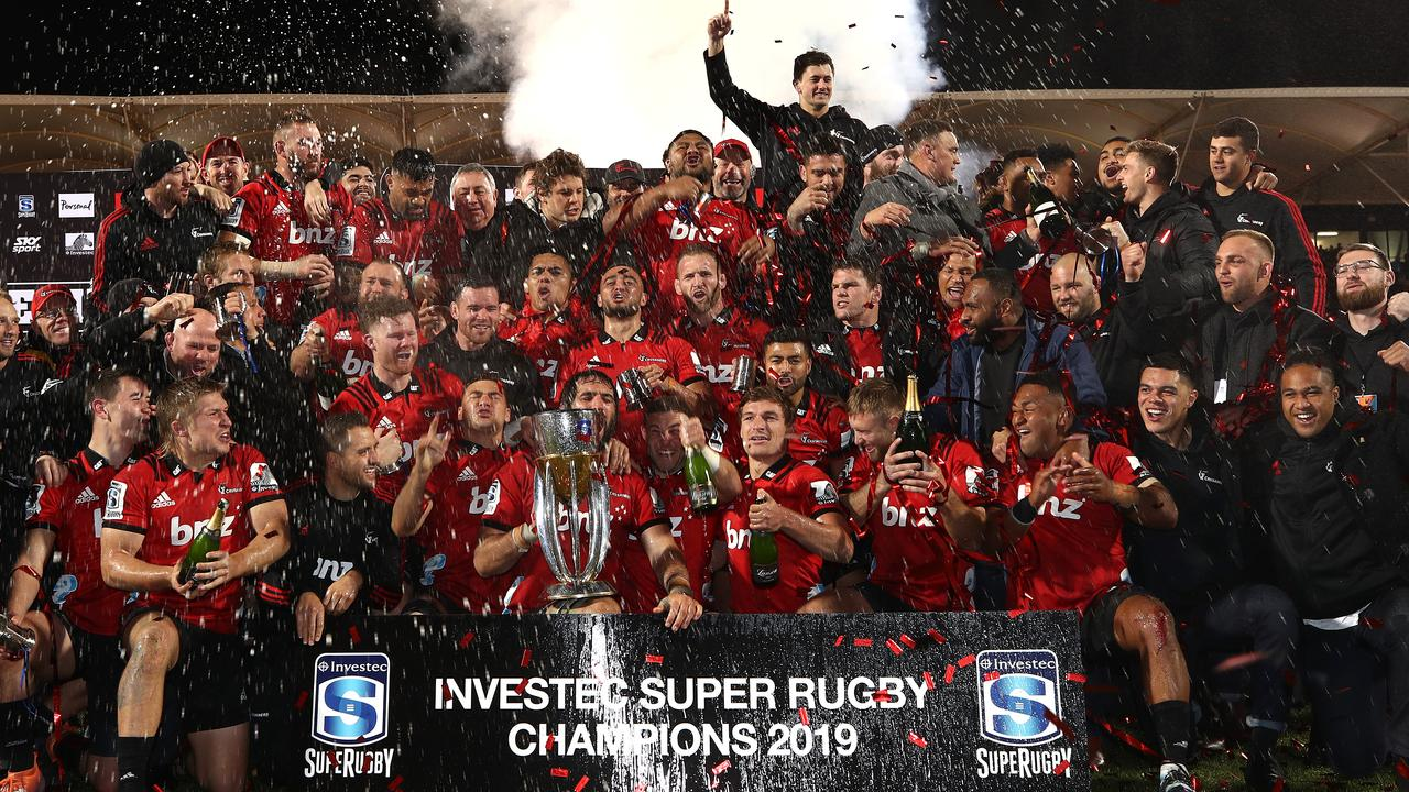 The Crusaders celebrate with the Super Rugby trophy.