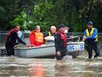 Jennifer and Wayne Garvey are rescued by Townsville Water Police from their Queens Road home in Hermit Park. Picture: Zak Simmonds