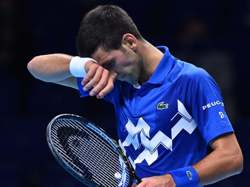 Serbia's Novak Djokovic reacts during his match agaainst Russia's Daniil Medvedev during their men's singles round-robin match on day four of the ATP World Tour Finals tennis tournament at the O2 Arena in London on November 18, 2020. (Photo by Glyn KIRK / AFP)