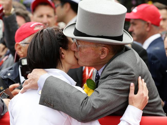Lloyd Williams gives 2015 Melbourne Cup-winning jockey Michelle Payne a kiss. Picture: Norm Oorloff