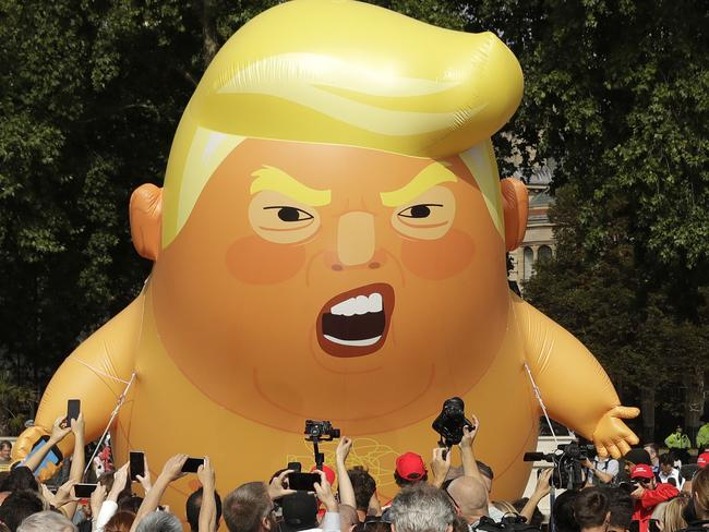 A six-metre-high cartoon baby blimp of US President Donald Trump is flown at a protest against his visit, in Parliament Square in London. Picture: Matt Dunham