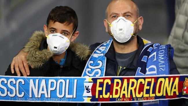 Fans wear medical face masks as they await kick off prior to the UEFA Champions League round of 16 first leg match between SSC Napoli and FC Barcelona at Stadio San Paolo on February 25, 2020 in Naples, Italy. Picture: Michael Steele/Getty Images