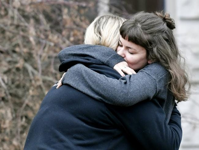 People hug outside of Kyle Yorlets' memorial service. Picture: AP