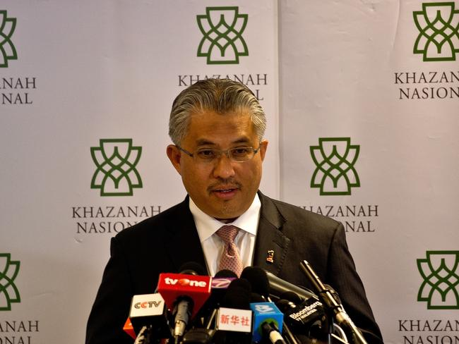 Rescue mission ... Khazanah Nasional Berhad managing director Azman Mokhtar details its plan to turn around crisis-hit Malaysia Airlines. Picture: AFP/MANAN VATSYAYANA