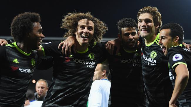 David Luiz leads celebrations.