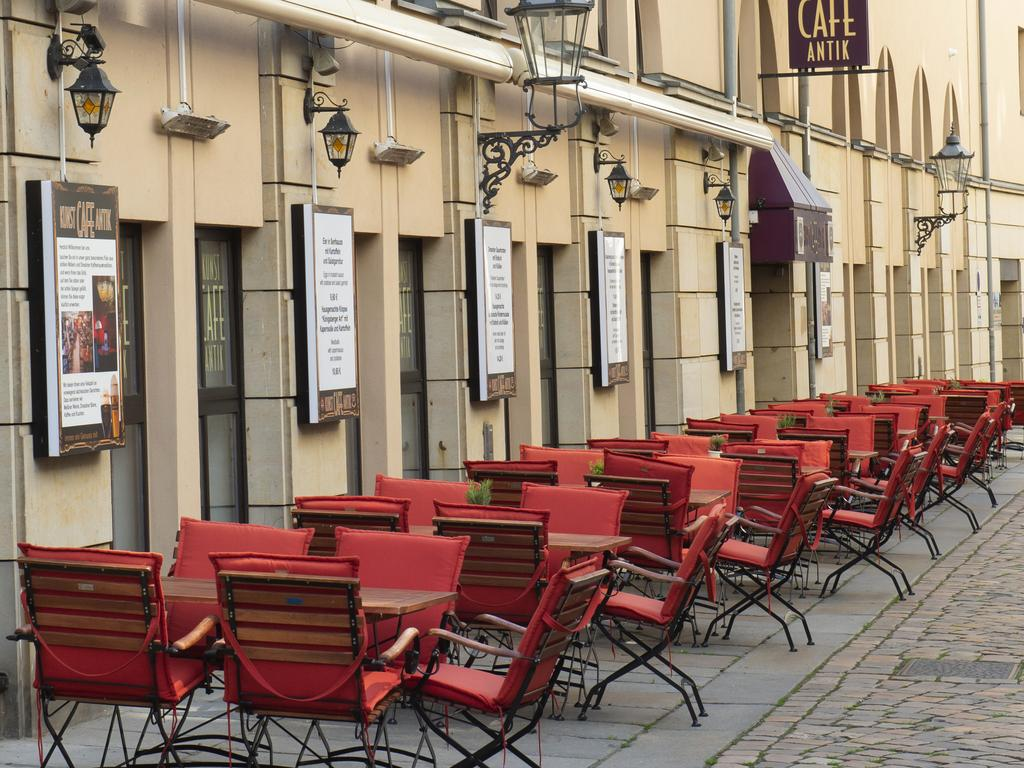 Tables and chairs stand outside of a restaurant after the reopening at the old town in Dresden, eastern Germany. Picture: AP