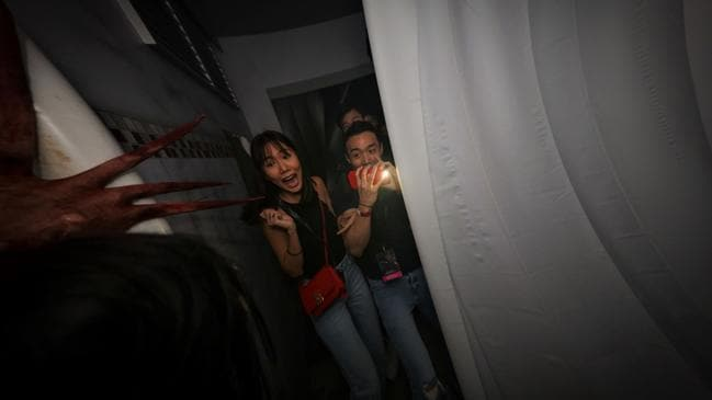 Guests are confronted by the Langsuyar in The Chalet Hauntings at Halloween Horror Nights.