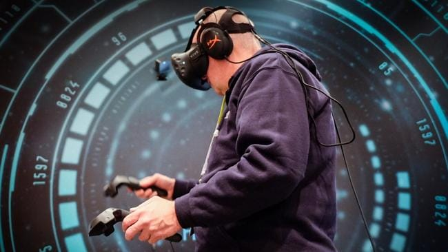 HTC's virtual reality ... Chris Griffith tries out HTC Vive, a virtual reality headset at the CES tech show in Las Vegas. Picture: Supplied.