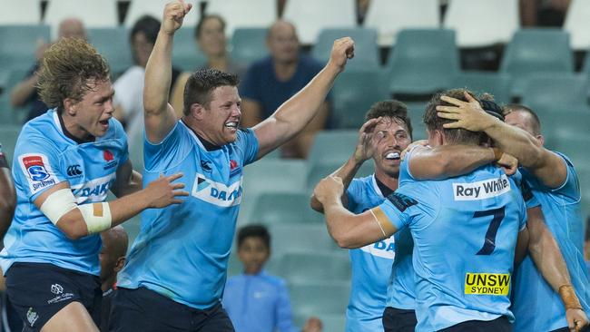 The Waratahs celebrate after a try by Michael Hooper during the Super Rugby round 2 match between the New South Wales Waratahs and the South Africa Stormers at Allianz Stadium in Sydney, Saturday, February 24, 2018. (AAP Image/Craig Golding) NO ARCHIVING, EDITORIAL USE ONLY