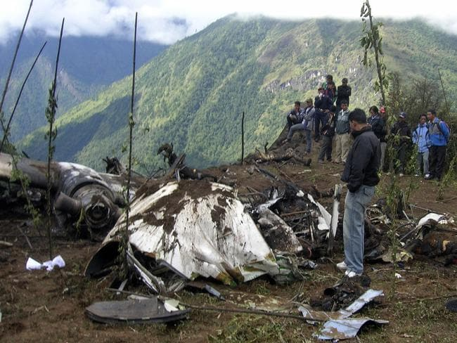 People stand around the wreckage of a Yeti Airlines plane in 2008.