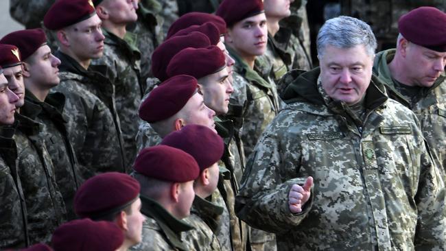 Ukrainian President Petro Poroshenko speaks to Ukrainian servicemen. Picture: AFP