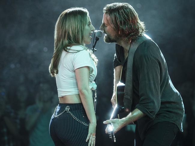 "This image released by Warner Bros Pictures shows Lady Gaga, left, and Bradley Cooper in a scene from ""A Star is Born."" Picture: Clay Enos/Warner Bros via AP"