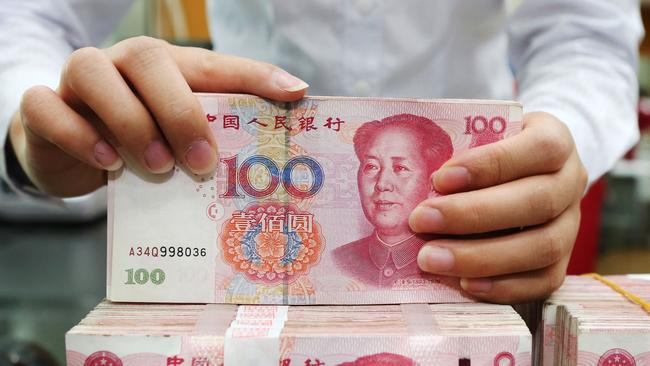 Chinese authorities are literally cleaning the country's currency to stop the spread of the coronavirus. Picture: AFP