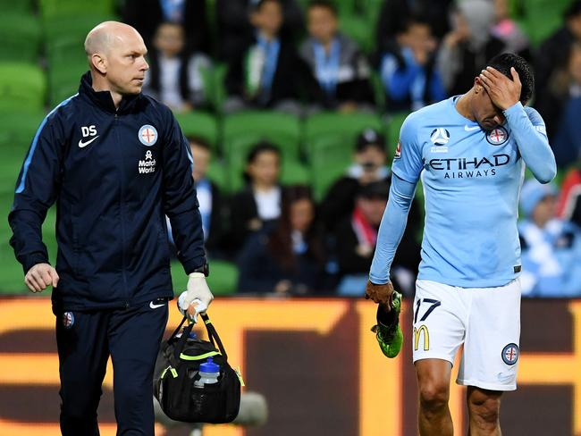 Tim Cahill limps off after injuring his ankle against Sydney FC. Picture: AAP