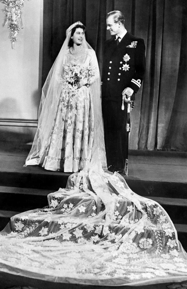 Princess Elizabeth of England and Philip The Duke of Edinburgh pose on their wedding day in 1947 at Buckingham Palace. Picture: AFP
