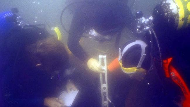 Divers studying a ship at the Newport site where the Endeavour is believed to be among 13 shipwrecks.