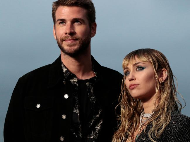 Liam Hemsworth and Miley Cyrus. Picture: Kyle GRILLOT / AFP.