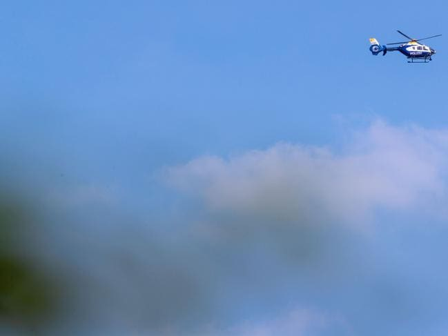 A police helicopter flies over the site of a crash between two Eurofighter jets of the German Air Force. Picture: AFP