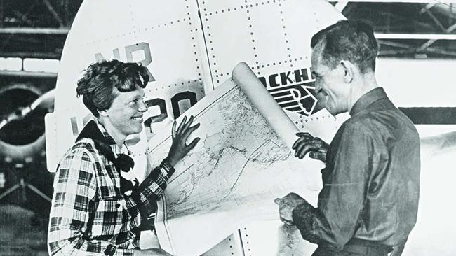 Pilot Amelia Earhart and her navigator, Fred Noonan, with a map of the Pacific that shows the planned route of their last flight. Photo: Getty Images