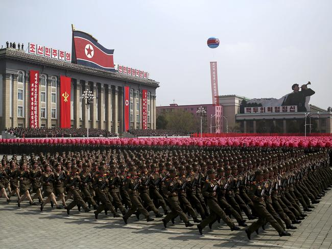 Soldiers march across Kim Il Sung Square during a military parade in Pyongyang, North Korea. Picture: AP Photo/Wong Maye-E