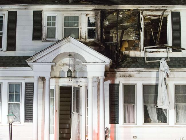 Firefighters inspect a home after a gas explosions in North Andover. Picture: Getty.