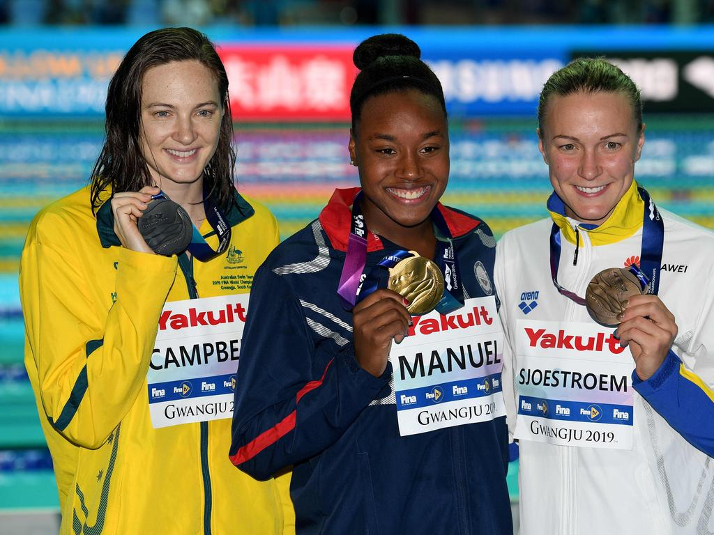 Gold medallist  USA's Simone Manuel (C), silver medallist (L) Australia's Cate Campbell (L0 and bronze medallist Sweden's Sarah Sjoestroem (R) pose after the final of the women's 100m freestyle event during the swimming competition at the 2019 World Championships at Nambu University Municipal Aquatics Center in Gwangju, South Korea, on July 26, 2019. (Photo by Oli SCARFF / AFP)
