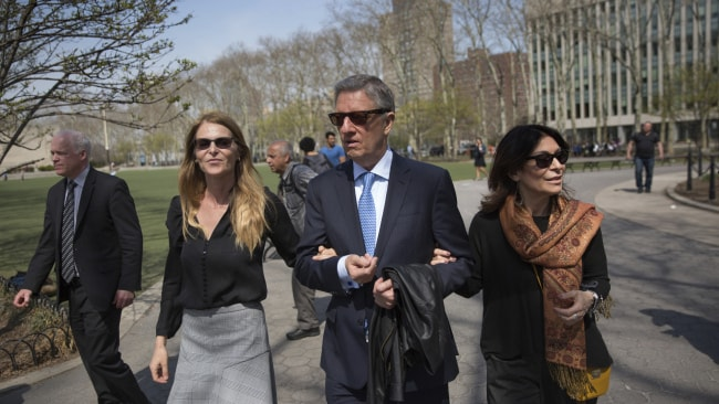 Actress Catherine Oxenberg, left, departs with Stanley Zareff and Toni Natalie, who is Keith Raniere's ex-girlfriend, following the arraignment of NXIVM leader Raniere in federal court on Friday, April 13, 2018. (AP Photo/Kevin Hagen)