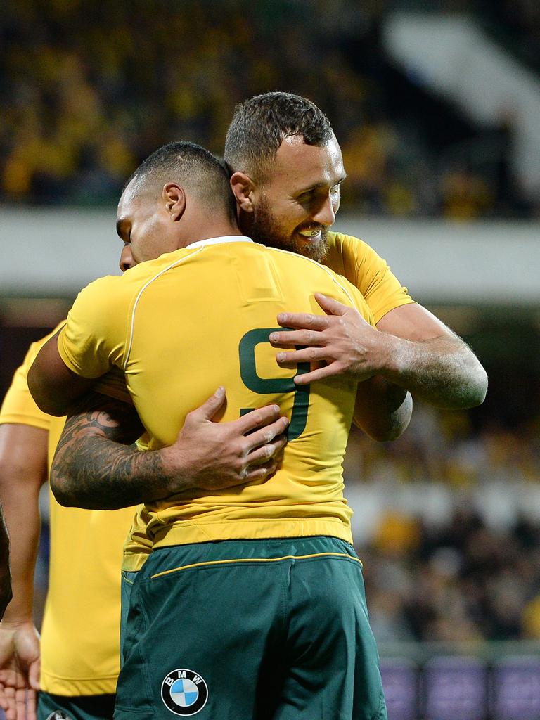 Quade Cooper hugs Will Genia during a Wallabies Test.