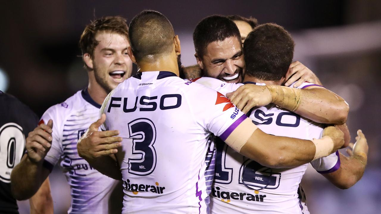 Jesse Bromwich celebrates with his teammates after scoring a try.