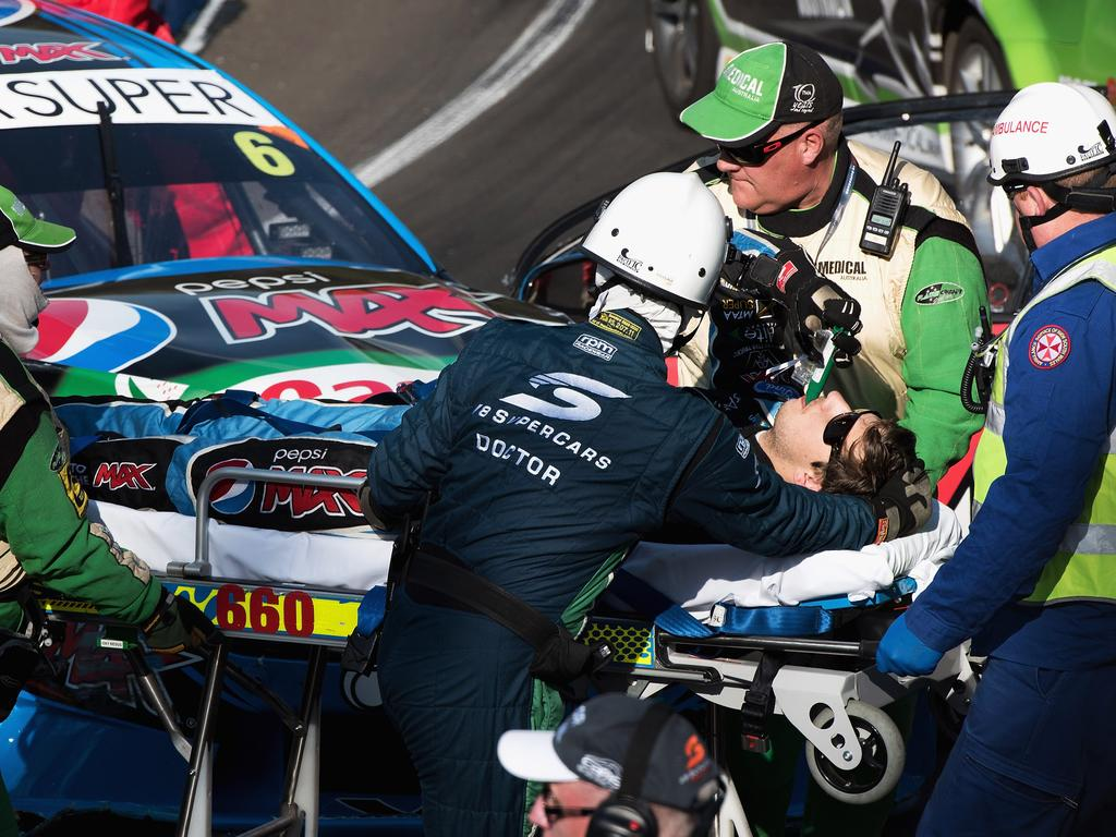 BATHURST, NEW SOUTH WALES - OCTOBER 09:  Chaz Mostert driver of the #6 Pepsi Max Crew PRA Ford FG X Falcon is removed from his car by medical staff after crashing out during qualifying which has been cancelled for the Bathurst 1000, which is race 25 of the V8 Supercars Championship at Mount Panorama on October 9, 2015 in Bathurst, Australia.  (Photo by Daniel Kalisz/Getty Images)