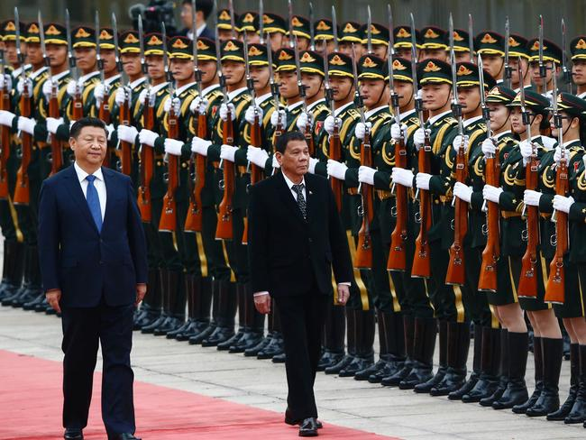Philippines President Rodrigo Duterte and Chinese President Xi Jinping review the guard of honours as they attend a welcoming ceremony at the Great Hall of the People in Beijing on October 20, 2016. Picture: Thomas Peter