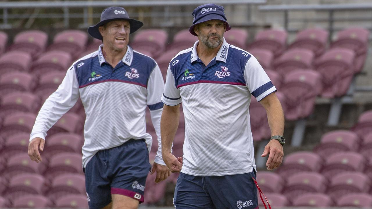 Reds coach Brad Thorn and defence specialist Peter Ryan at training at Ballymore. Credit: QRU Media — Brendan Hertel.