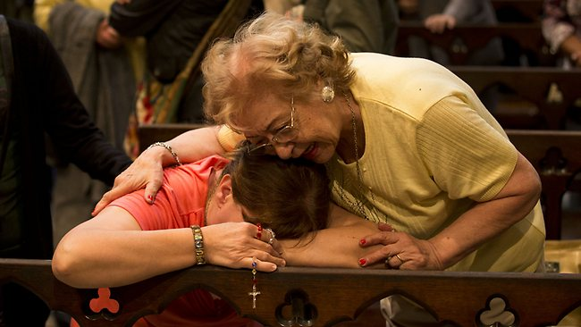 Women react after hearing on the speakers at the Metropolitan Cathedral in Buenos Aires that Archbishop Jorge Bergoglio was chosen as Pope. Picture: AP