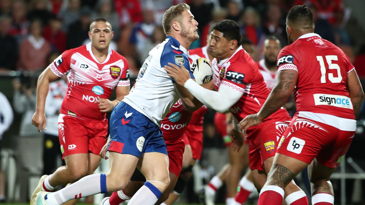 Tom Burgess of Great Britain is tackled by Jason Taumalolo captain of Tonga