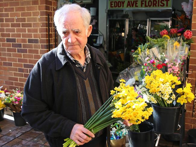 Danukul Mokmool was shot dead by police at Central Station after threatening florist Manuel Theoharis (pictured) and holding a broken bottle to his throat. Picture: Toby Zerna