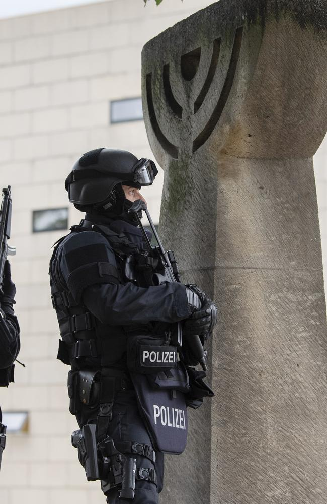 Police secure a synagogue in Halle, Germany, after a gunman opened fire, killing two people. Picture: AP
