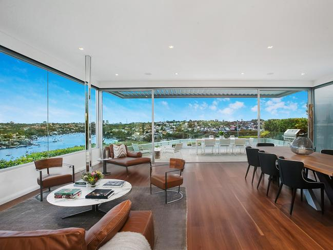 The Mosman home has cracking views looking over Quakers Hat Bay.