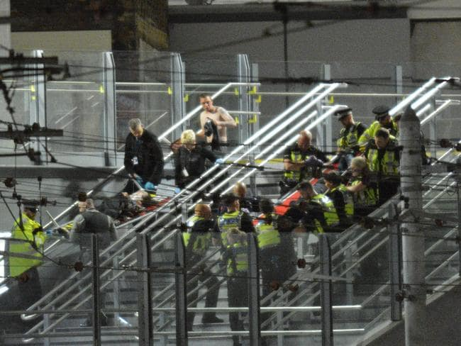 Casualties being carried out of the Manchester Arena on barriers after an explosion at the Ariana Grande gig. Picture: icelebtv