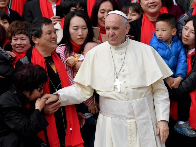 Pope Francis greets faithful from China on St. Peter's square in the Vatican. Beijing has been cracking down on Catholics inside China. Picture: AFP