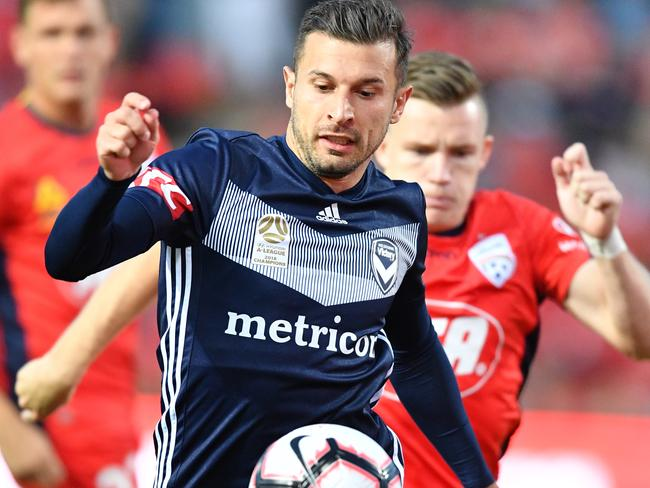 Kosta Barbarouses in action for Melbourne Victory against Adelaide United on Wednesday night. Picture: AAP