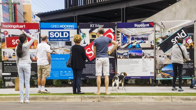 A common difference of opinion between couples includes whether to buy an apartment close to the city or a freestanding house further out. Picture: iStock